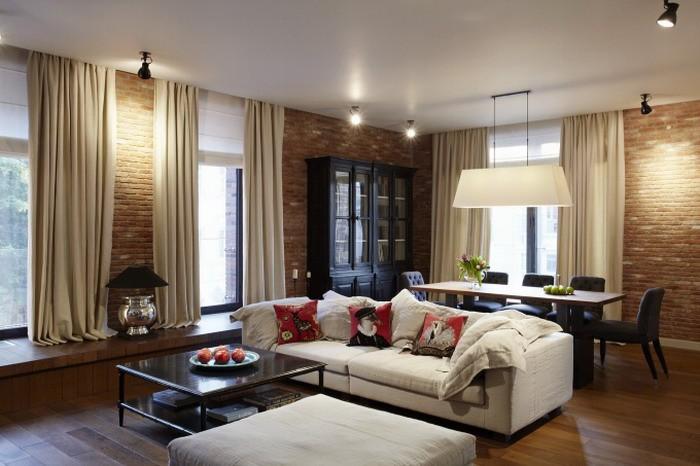 Привлекательный интерьер гостиной-столовой-кухни