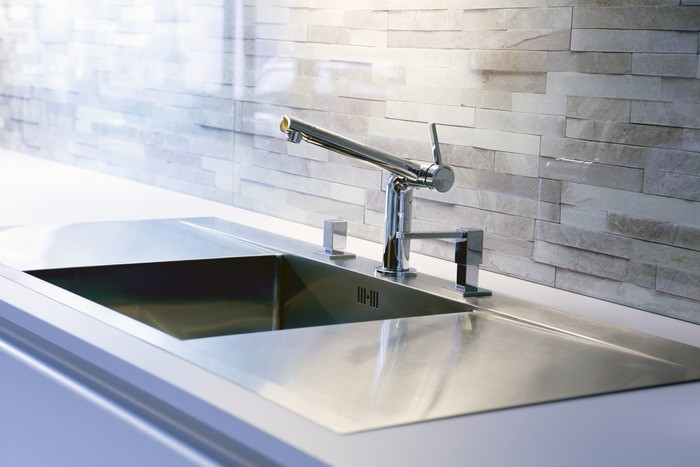 close-up of modern stainless steel kitchen sink
